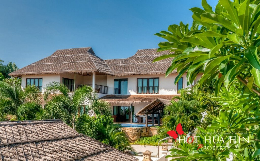 Large tropical house with lush exotic views